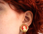 vintage 80s orange coral cameo clip on earrings