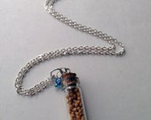 Seed of Faith Mustard Seed Capsule with blue beads