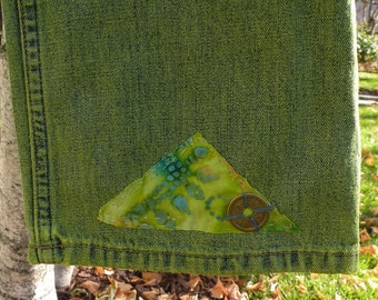 "JEANS mid-rise blue denim boot cut over-dyed green, estimated size 5/6, marked 28"" waist Chinese coin, boho batik applique, inseam 32"""