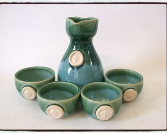 Fleur de Lis Sake Set for Four with Heart Spout in Turquoise/Green Glaze by misunrie