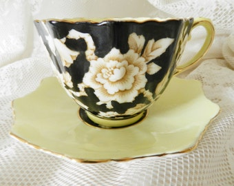 Paragon Teacup,  Yellow Wild Rose Teacup, Yellow Paragon Teacup, Black Teacup and Saucer  no2A