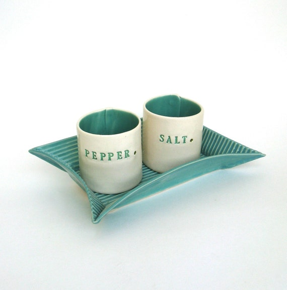 Clay Swan: hand built porcelain salt and pepper cellars sitting on a tray