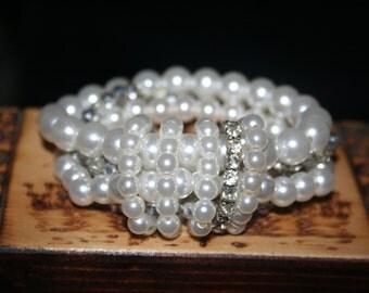 SALE ...Vintage Bracelets ,Bunch of fake Pearls , rhinestone bracelets ,sparkly beads bracelet all together Stunning