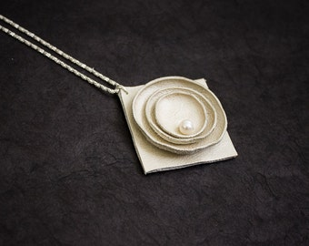 Minimalist leather pendant with a pearl. Necklace.
