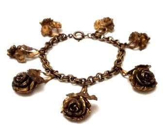 Early Leo Glass Bracelet, 1940s Leo Glass Floral Charm Bracelet, Repousse Brass Charms, Vintage Designer Costume Jewelry Brass Flower Charms