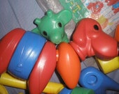 free ship,EXCELLENT CONDITION, TUPPERWARE  'zoo-it' build an animal toy, bag has alot of folds in it... but the original