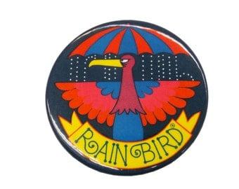 Rain Bird Button Pin Pinback 1970s Sprinkler Company? umbrella