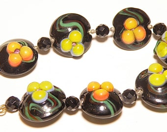 DESTASH -- Set of Seven (7) Black, Yellow, Orange, and Blue Floral Lampwork Lentil Beads - Lot AA