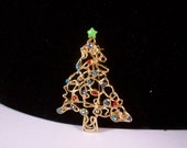 Vintage Delicate Christmas Tree Brooch not signed unknown age in mint condition