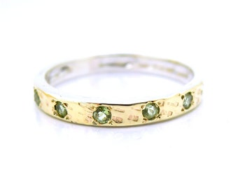 Peridot ring with hammered gold on silver