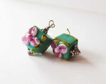 Green lampwork earrings.  Bali silver earrings.  Flower earrings.  Pink earrings.  Green jewelry.  Lampwork jewelry.  Glass earrings.