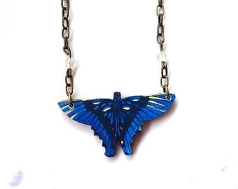 Butterfly necklace deep indigo blue wings, moonstone colored crystal beads in chain