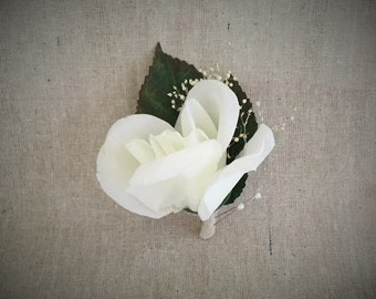 Ivory rose boutonniere with dried baby's breath and linen backing