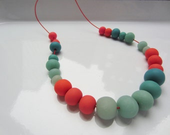 handmade polymer clay bead necklace in Coral Blues, Elastic cord, Handmade Beads, Colorful Beads, Made in New York