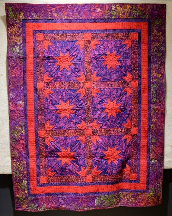 Hunter star batik purple and red wall hanging quilt