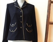 1960s Boxy Black Blazer with Gold Piping on Collar Placket Pockets Cuffs Tortoiseshell Lucite Buttons Tres Chic