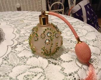 Jeweled pink perfume bottle