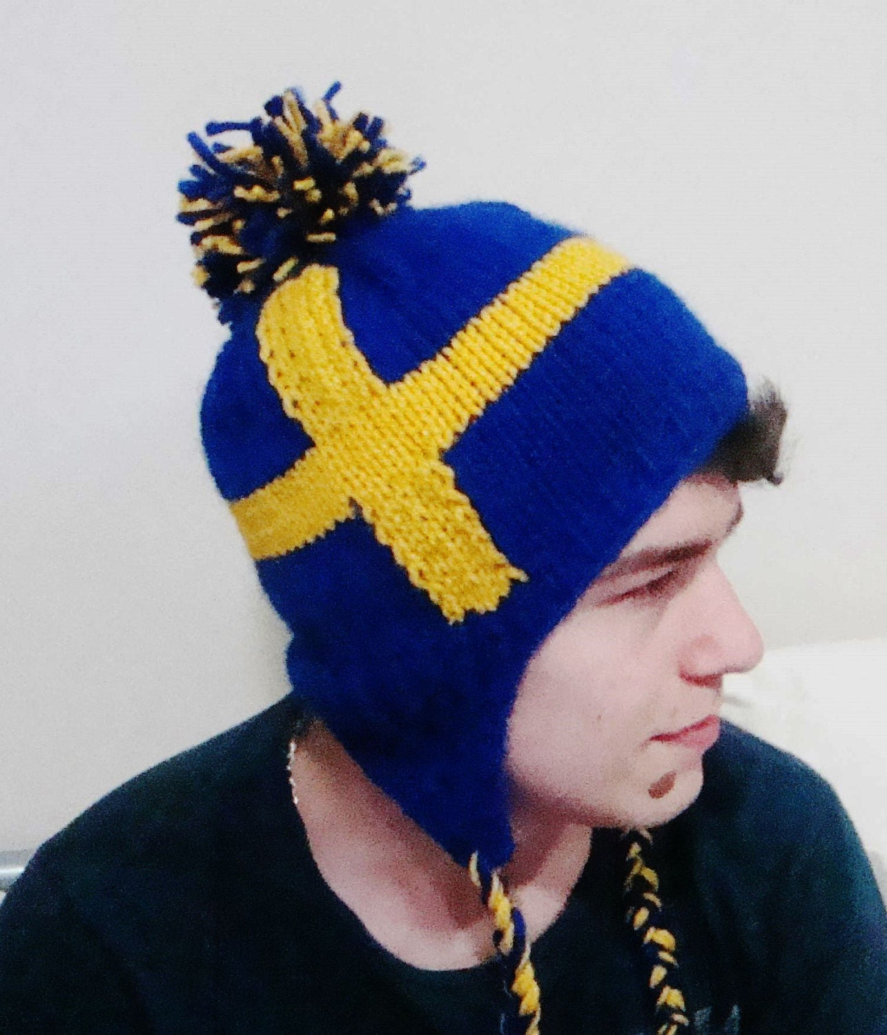 swedish flag beanie hat with ear flap hat a blue field with a