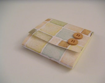 Pastel Brown, Orange, Blue, and Green Square Print Sticky Notes Pad with Orange Buttons