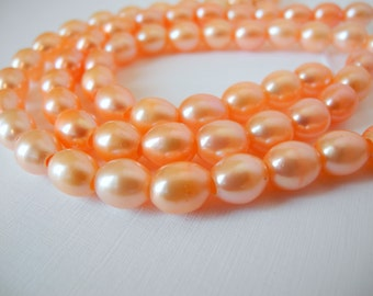 Freshwater Large Hole Rice Pearls Peach Pink Pale Orange 9mm Full Strand 20 Pieces