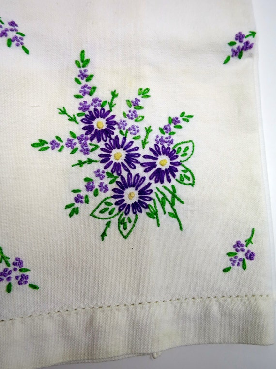 White tea towel embroidered purple flowers green leaves hand