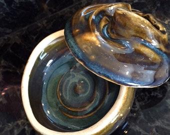 This is a beautiflul lidded ceramic jar