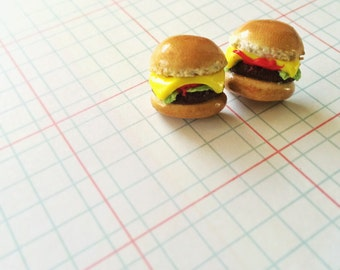 Polymer clay cheeseburger earring studs.