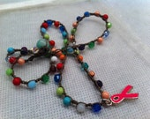 BREAST CANCER Pink Ribbon Charm on a Multi Colored Beaded Crocheted Necklace