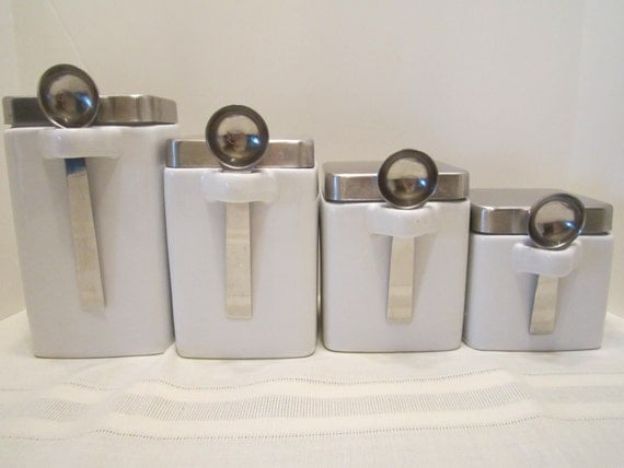 white ceramic kitchen canisters with stainless steel lids and