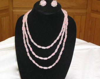 Vintage pink signed Japan very long plastic translucent necklace and clip earrings