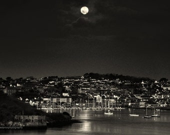 the moon setting behind kinsale in west cork ireland
