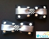 Black, grey, and white hair bows. Portion of sale goes to charity.