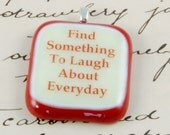 find something to laugh about everyday fused glass pendant red and cream