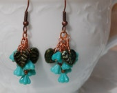 Turquoise Czech Glass Baby Bell Flower Dangle Earrings in Copper ........item number 381