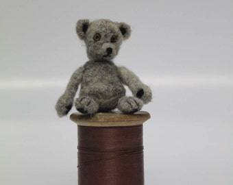 Needle felted teeny teddy bear