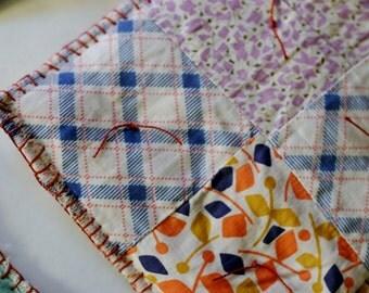 2 Vintage Quilt Potholders - Orange Blanket Stitch Edge