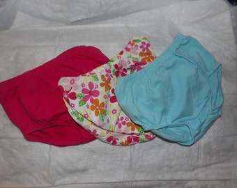 3 pair of 3 months to 6 months diaper covers in dark pink, floral print and lite blue - dcs3