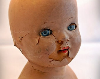 blue eyed doll art photo, broken doll, outsider art that might be a little creepy or scary, creepy doll head for Halloween
