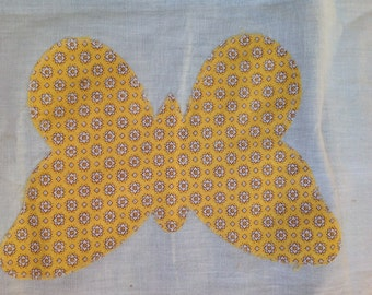 Butterfly quilt pieces in various stages of construction.