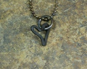 "Forged iron ""pipe dream"" heart pendant -- i11527"