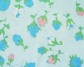 Vintage 1950s highquality unused flanell cotton fabric with small printed blue/ pink/ white rosebud pattern on light blue bottomcolor