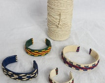 Vintage Rexlace Roll of White Plastic Ribbon or Lacing  and Four Colorful Bracelets - box b