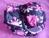 SassyCloth one size pocket diaper with pink flowers on black PUL. Ready to ship.