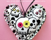 Hand Stitched Skull Fabric Heart Ornament. Pink and chartreuse (green yellow) buttons. Bright green and pink embroidery floss stitching.