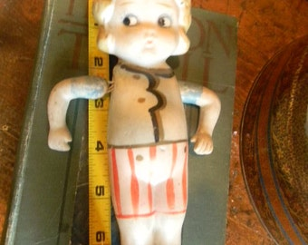 FROZEN CHARLOTTE 1920s Doll. Movable arms. Striped Swimsuit .Made in Japan. WW 11 Era