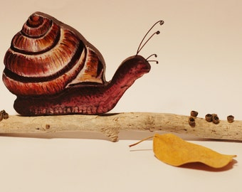Snail on driftwood free standing sculpture