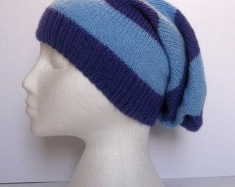 Unisex hand knitted super slouchy beanie hat. Adult or teenager. Light purple and blue stripes.