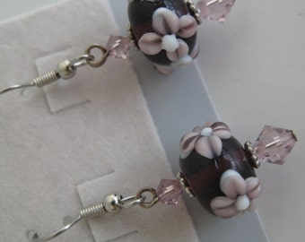 Purple floral lampwork bead earrings with Swarovski crystal accents.