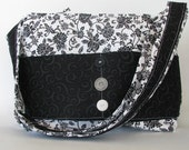 White background with black flower purse