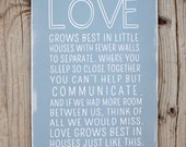 Love Grows Best In Little Houses sign